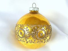 Gorgeous vintage, large golden Shiny Brite Christmas tree holiday ornament is decorated in a swirl pattern with black mica.