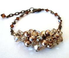 Pearl crystal chunky bracelet, champagne bronze bead cluster centerpiece on chain, antiqued brass wire wrapped brown monochrome Fall jewelry Fall Jewelry, Brass Jewelry, Beaded Jewelry, Handmade Jewelry, Jewelry Ideas, Diy Jewelry, Crystal Beads, Swarovski Crystals, Crystal Cluster