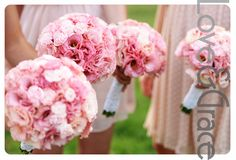 Round Pink peonies wrapped with white Ribbon.