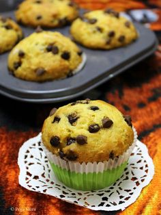 Eggless Orange Chocolate chip Muffins - Made with fresh orange juice and loaded with choco chips.