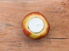 DIY Apple Votive Centerpieces | HGTV >> http://www.hgtv.com/design/make-and-celebrate/handmade/diy-apple-votives-for-fall?soc=pinterest