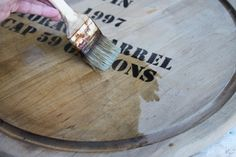 Steel wool soaked in vinegar=distressed wood.  who knew? DIY Lazy Susan from wine barrel