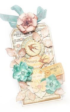 really like the flower with ribbon at the tag top.  Designed by Karola Witczak