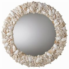 Clearwater Round White Natural Shell Mirror offers pristine, simple yet elegant style, perfect in any coastal decor...or as intriguing texture and contrast in contemporary settings. Dimensions: D: 3 1/2'' • 31'' Dia