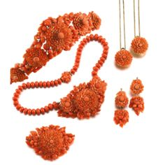 CORAL PARURE, MID 19TH CENTURY consisting of a necklace, earrings, a brooch, two hair pins, and a diadem.