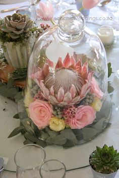 African flower arrangements. Taking the traditional protea flower and adding a 'chic' feel to it