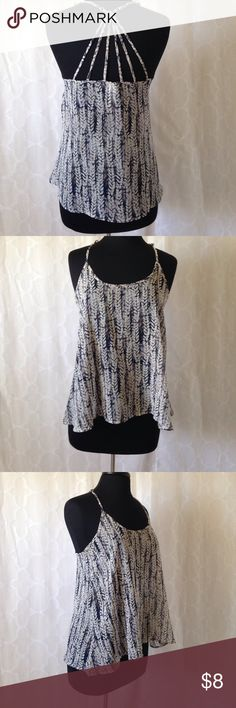 3/$15 Cute, flowy, Tank with cool back design and adjustable straps. Like new. No flaws. Perfect for hot days. 3/$15 or $8 if sold separately Aeropostale Tops Tank Tops