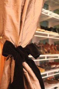 Use velvet ribbon tied in a bow as a decorative curtain tieback!