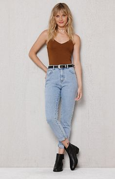 The Steve Blue Mom Jeans have a rigid fabrication for a nod to throwback fashion. They offer a super high rise fit, naturally cinched waist, relaxed leg and light blue wash.
