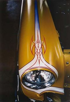 Beautiful pin striping around a headlight and up a fender.