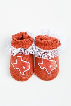 Pass on the Game Day tradition to your newest Longhorn with the Infant Burnt Orange Texas Lace Booties! These newborn booties feature the state of Texas with a star in the location of Austin and white lace surrounding the ankles.  75% Cotton / 20% Nylon / 5% Spandex