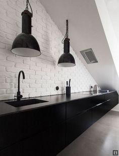 Sleek, minimal black & white galley kitchen
