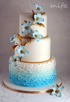 Beautiful blue and gold wedding cake by mifa.