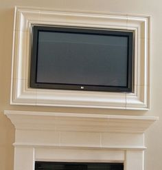 picture framed flat screen tvwould love this around our tv but