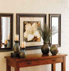 ELEGANT BLOSSOM magnolia still life is double matted in a self mat and  cappuccino and framed with glass in bronze highlighted dark walnut moulding. 29x29  #74802 $139.00  www.celebratinghome.com/sites/angela4barnes
