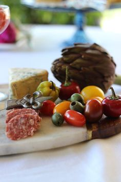 Olives, cheeses and meats for the perfect board spread.