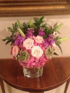 Sweet Arrangement using light pink roses, antique Hydrangea, lilies and green filler