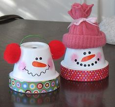 Clay pot snowmen    Step 1: Getting Started  I was inspired to make these from a clay pot snowman project I saw on Hobby Lobby. They painted their scarves, but I decided to use Mod Podge and scrapbook paper. They used clay for the noses, but my faces are painted on. These cute little snowmen would make wonderful teacher's gifts!  And this craft cou
