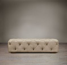 Soho Tufted Upholstered Ottoman -- comes in many colors. The tufting in this makes it sculptural and would work very, very well in your living room.