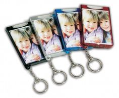 A great Photo Keychain and a Bright Flashlight all in one!  Show off your favorite photo and always have a brilliant lighted keychain handy.  Available in Black, Silver, Translucent Red, and Translucent Blue. Keychain includes the photo and you can choose from horizontal or vertical layouts.