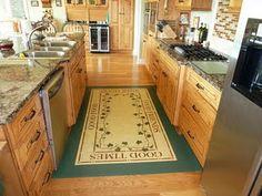 DIY Floor Cloth using vinyl flooring scraps...paint your design and finish with 3 coats polyurethane. Super simple.
