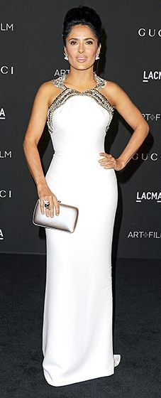 Could she be more perfect? Salma Hayek showed off her hourglass figure in a white Gucci gown with a diamond encrusted bodice.