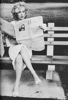 Marilyn reading paper in the park