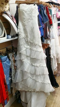 Size 10 Strapless Wedding Dress with Layered Lace Detail, from Mind Charity Shop in Harrow.