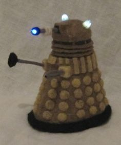 Light up Dalek Plush...this is needle-felted...I'd try sewing...maybe with pom poms for the knobs
