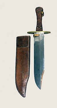 Confederate bowie knife. This bowie knife was found on the battlefield of Perryville, Kentucky. It is brass mounted and has wooden grips and a blade 12 7/8 inches long. The bowie is usually classified as any large knife with a chipped point. This type of knife was popular from the 1840s through 1865. They were used by United States troops during the Mexican War and on the frontier during the disturbances in Kansas and Missouri in the 1850s.