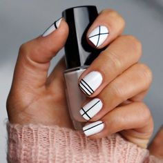 Better-Than-Basic White Nail Designs - More : Nail art tape makes delicate manicures a piece of cake. Use your imagination, or re-create this clean, modern black-and-white look. Black Gel Nails, Black White Nails, Matte Nails, Glitter Nails, White Manicure, Oval Nails, Black Stripes, White Short Nails, Black Pedicure