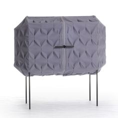 cabinet enveloped in pleated purple material by Meike Harde
