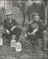 Jim Yates & Roosevelt Ficht with jars of moonshine, 10 miles south of Kingston in Madison County, December Photo courtesy of the Shiloh Museum of Ozark History Vintage Pictures, Old Pictures, How To Make Moonshine, Moonshine Whiskey, Madison County, Shiloh, The Good Old Days, Distillery, Arkansas