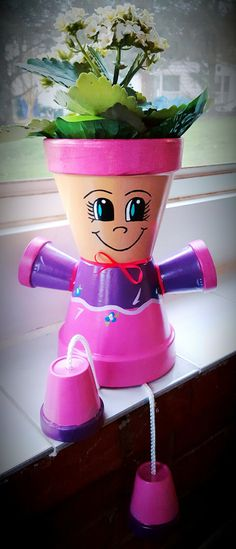 flower pots outdoor Pink/Purple Clay Pot Person / Flower Pot This girl would be perfect to add to your indoor or outdoor dcor! You can plant a flower in her or just leave her as is. Clay Pot Projects, Clay Pot Crafts, Diy Clay, Projects To Try, Flower Pot Art, Clay Flower Pots, Flower Pot Crafts, Flower Pot People, Clay Pot People
