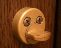 """Seeing patterns is in our genes, and yesterday I saw this duck-face on my toilet door.    Been sitting on that toilet for 6 months (not continuously), but I only just noticed that cute little buggar staring right at me."""