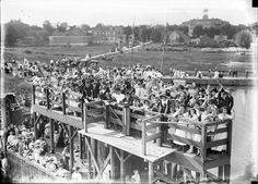Crowd on docks in Coburg waving as the car ferry Ontario I leaves. Rochester Common Council outing in Coburg. August 4, 1912. [PHOTO: Albert R. Stone]