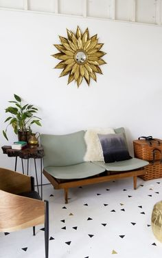 Geometric Stenciled Floor, DIY from Sarah Sherman Samuel for A Beautiful Mess & vintage sofa
