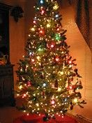 christmas tree with big colored bulbs and small white ones