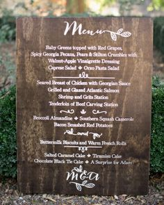 Wooden Menu: A large sign created by Back40Life listed the evening's cuisine, which was served buffet-style.