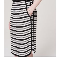 """NWOT LOFT Racer Stripe Jogger Skirt, size Small NWOT LOFT Racer Stripe Jogger Skirt, black/white, Sz S. Made with sportif seaming and in monochrome stripes. Breezy pencil skirt with ruched elasticized waist. Piped trim at slash pockets, side seams, and vented shirttail hem. 25"""" long. LOFT Skirts Pencil"""
