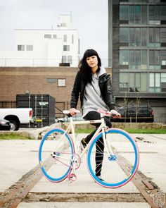 I love bright colours on bikes. She should take a cue from her ride.