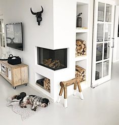 #Beachwood inspiration #Skill full use of space #corner fireplace #timber stools #Entertainment unit #storage