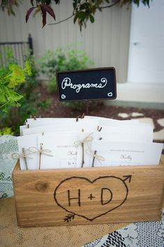 Embellish a wood box with your wedding initials using a wood burning tool, or have one custom made.
