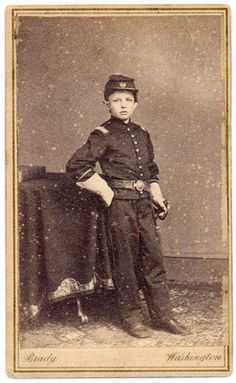 Rare photograph of Tad Lincoln posing in his exact replica of Union Soldier uniform made special for him by Sec. of War, Edwin Stanton. (Mathew Brady Washington D.C. Studio portrait).  *s*