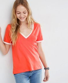 http://www.quickapparels.com/girls-v-neck-style-red-and-white-t-shirt.html