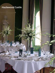 Hazlewood Castle - Orchid table decorations  www.uniqueweddingflowers.co.uk