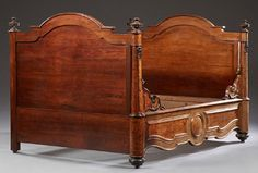 French Burled Walnut and Rosewood Lit du Coin, c. 1880, the arched head and footboard within turned tapered columns with ebonized applied carvings, joined by a wide serpentine front rail, also with ebonized applied carvings, en suite with previous lot, H.- 51 in., Int. W.- 52 in., Int. D.- 75 in.