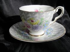 Royal Stafford tea cup and saucer, handpainted, floral, china, made in England, white, grey, yellow, pink, 1940's, excellent condition, by fabfunkyfunvintage on Etsy