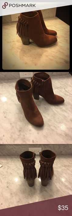 Brown fringe ankle booties Brand new Brown fringe ankle booties size 8 1/2 never been warm outside Shoes Ankle Boots & Booties
