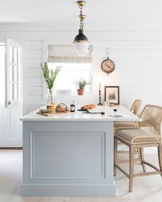 Beautiful kitchen with blue - grey island